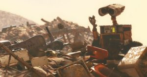 Wall-E inspecting all sorts of garbage that he found. Source: moviefone.com