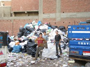 Some boys were standing in front of a pile of garbage in Manshiyat Nasser. Source: Ayoung0131/EnglishWikipedia