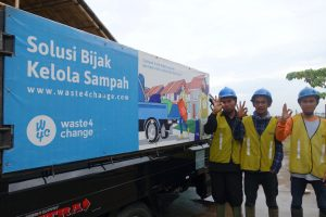 Waste4Change's operators posing in front of our garbage truck.