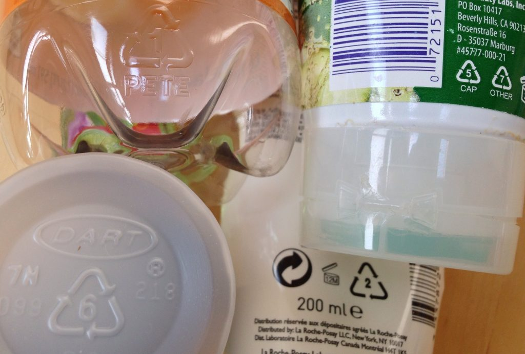 This is actually the plastic resin codes that have recycling symbol around it, doesn't mean that the material will be recycled later