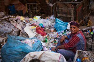 A woman sorting the garbage in Manshiyat Nasser. Credit: Scott Nelson/2009